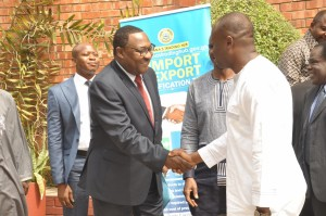 (R) Mr. Hassan Bello, Executive Secretary/CEO of the Nigerian Shippers Council in a warm handshake with Dr. Moane Baomah, Ghana's Minister of Communications